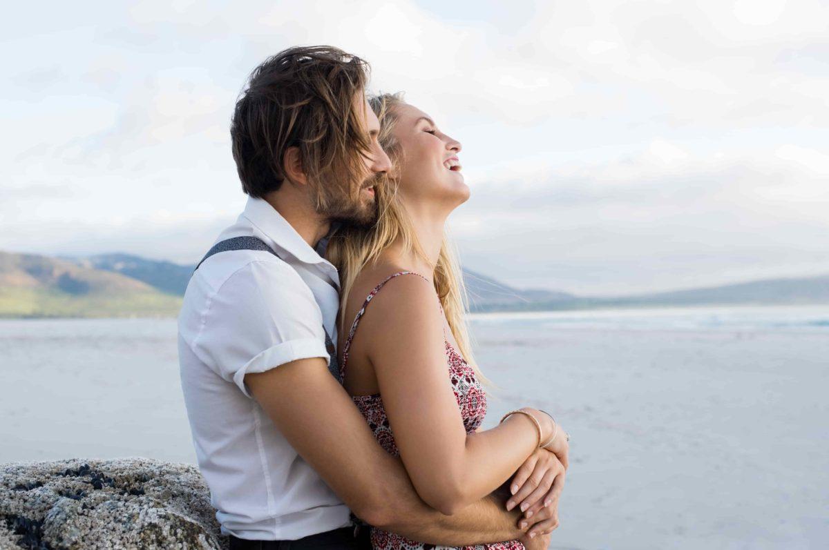 couple embrace whisper in ear