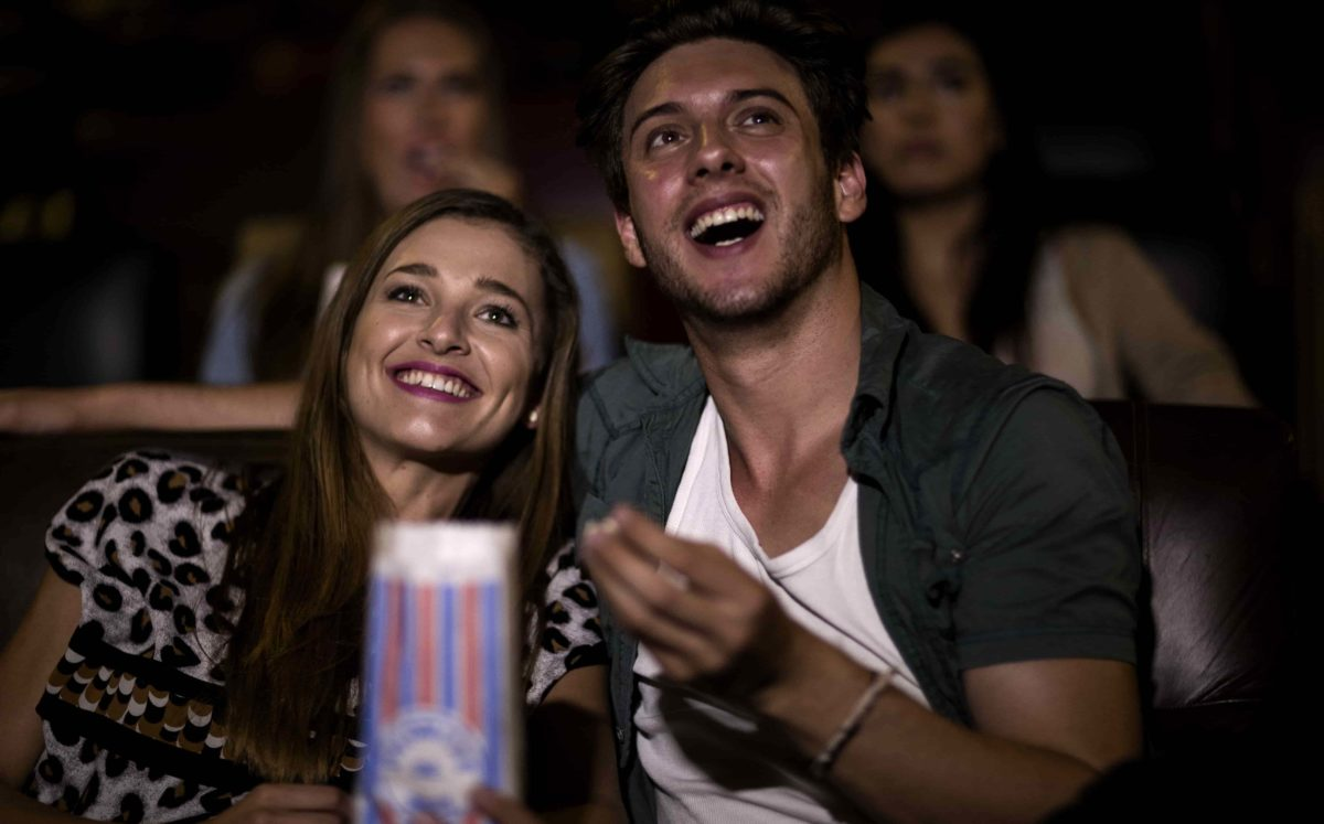 couple watching romantic movie at cinema